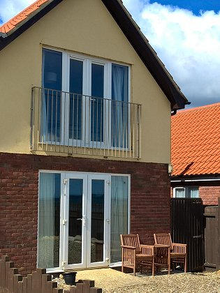 The beach house holiday cottage walcott north norfolk coast for Beach house description